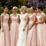 The bridesmaid is more than just a beautiful face clad in a beautiful bridesmaid dress, it's some work